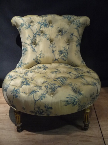 Silk covered low chair