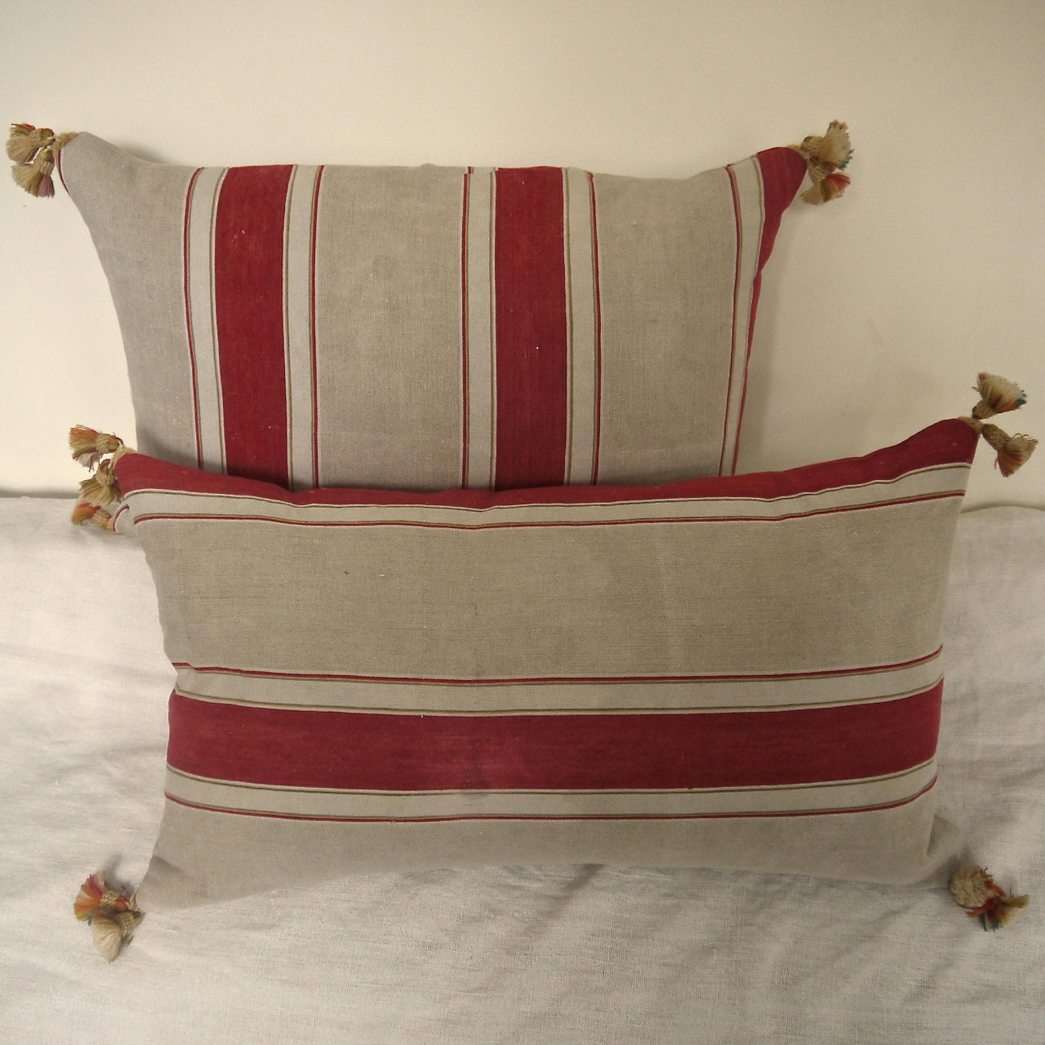 Two Antique French Red Ticking Linen Cushions