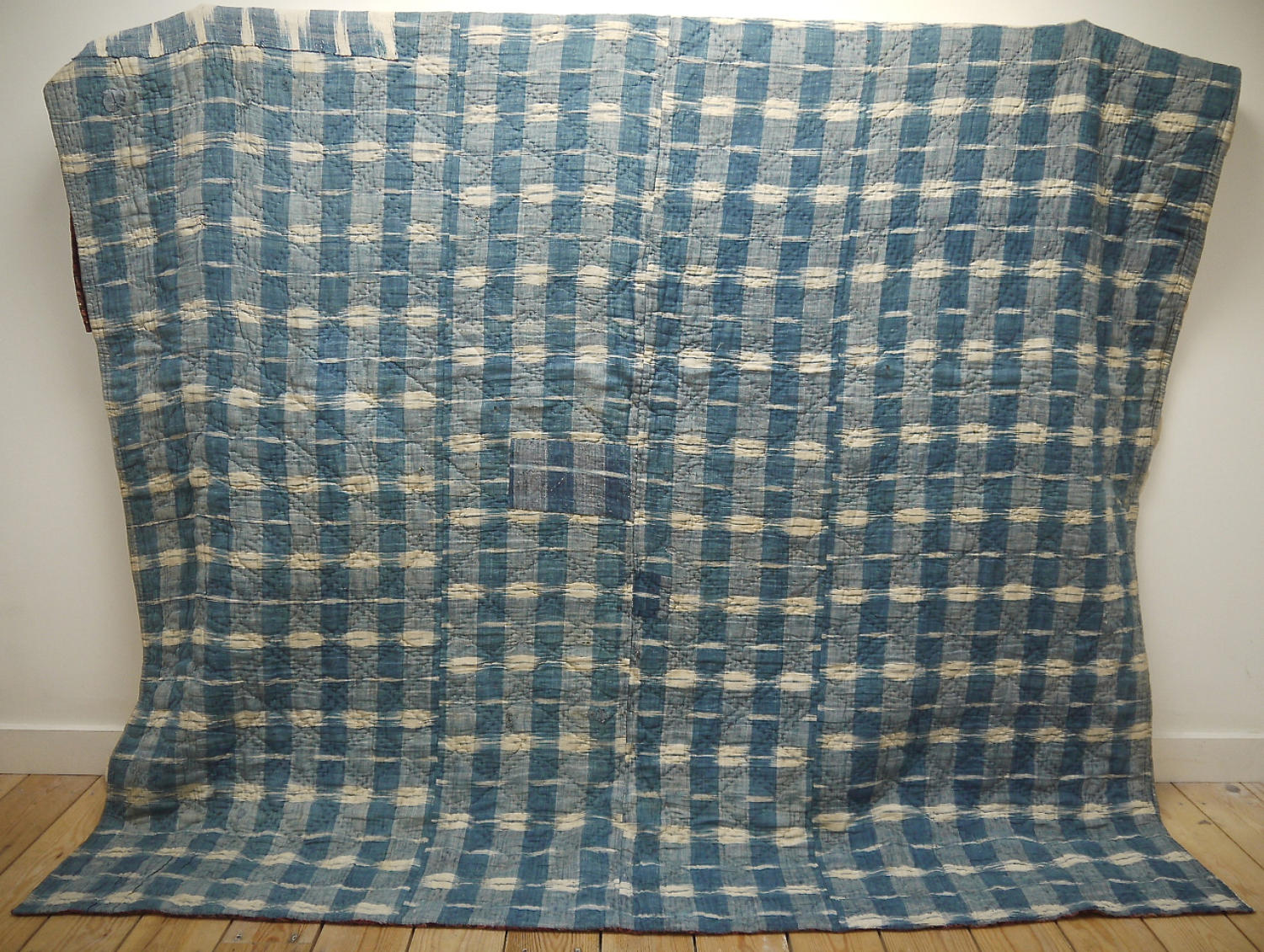 Late 18th century French indigo flamme and floral quilt