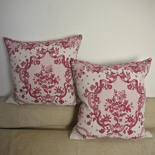 Pair of early 20thc French red and pink linen cushions
