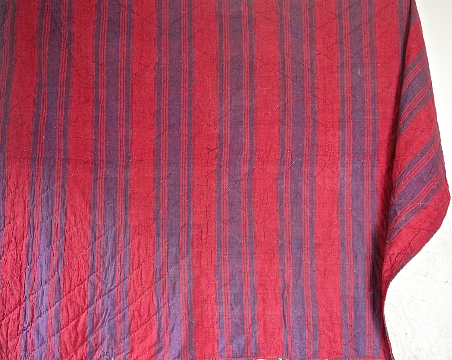 Late 18th century French indigo and red striped small quilt