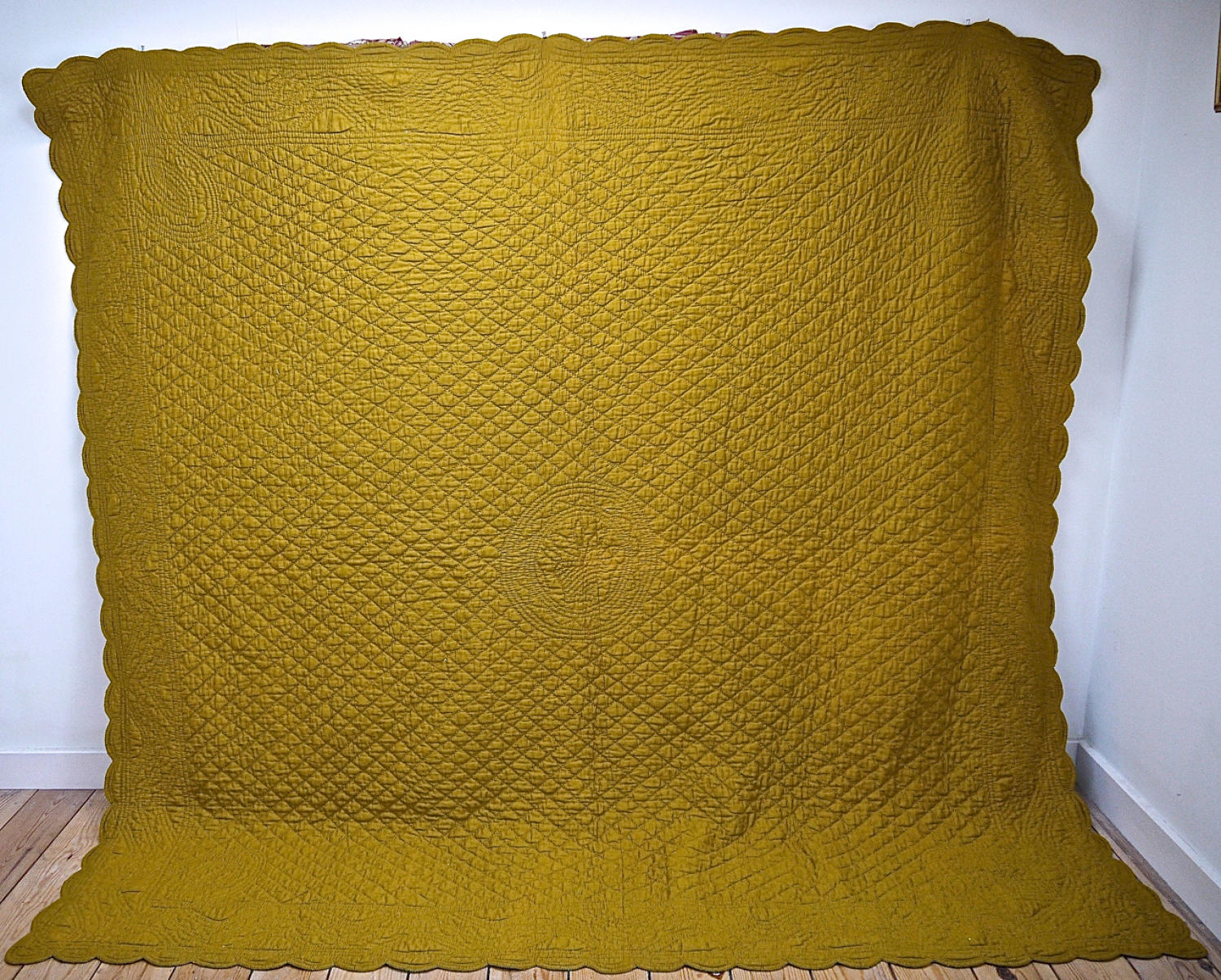 Early 20th century French mustard cotton quilt