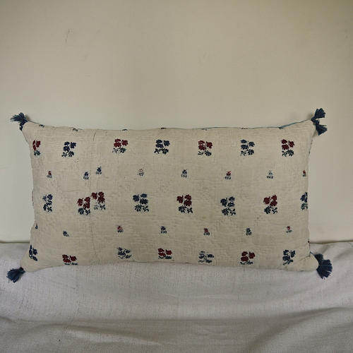 Wool woven flowers on linen cushion