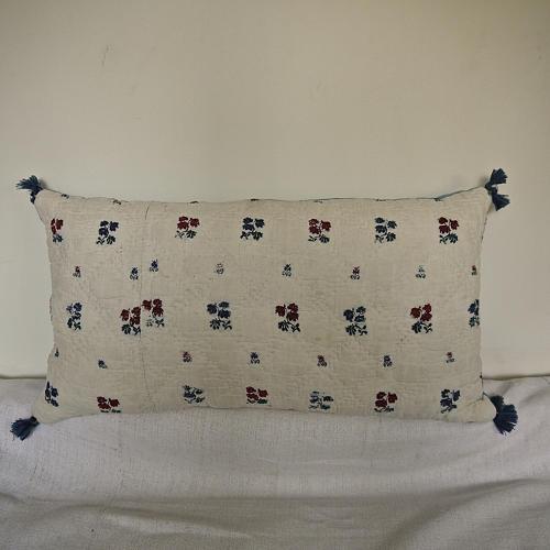 Wool woven flowers on linen cushion